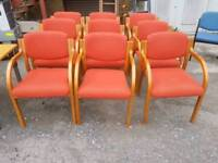 Chairs - Light Coloured Wood and Red Fabric Stackable Armchairs