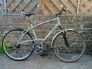 B-Twin Triban Trail Hybrid Trekking bike. Great condition. Front suspension, Shimano XT brakes.