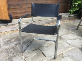 Chrome tubular chair with black leather seat and back. Good condition, slight scratches on chrome.