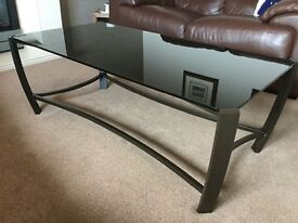 Coffee table with brown metal frame and black tempered glass