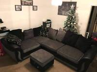 Black and grey corner sofa and storage foot stool