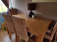 Dining table and 4 wicker chairs