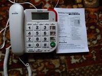 Telephone with large numbered keys and photos