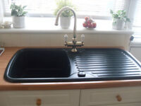 kitchen sink & gold coloured mixer taps