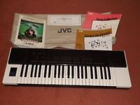 JVC electric keyboard. Model KB-300. Includes cover, owner's manual and song collection