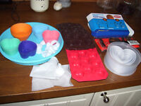 Assorted baking items,silicone bakeware, icing set, cutters, silicone moulds