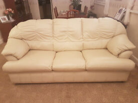 3 piece leather suite in creamy beige inc. 2 reclining chairs.