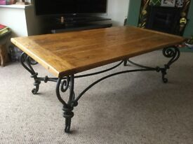 For sale - An Oak top coffee table with cast iron decorative legs. Excellent condition.