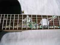 Tanglewood electric guitar with inlaid fretboard - Planets scene.