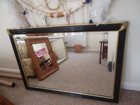 Black and gold framed beveled mirror 102cm x 72cm in Saltdean