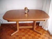 Solid teak extending dining table