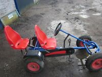 Red Berg 2 seater Go Kart. Rarely used. Great item for playing on outdoors. Only 18 months old
