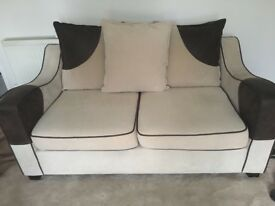 2 x two seater Sofas and Footstool