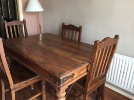Table and 4 chairs for sale dark wood very sturdy few marks can be upcycled