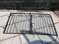 Pair of centre folding wrought iron driveway gates.