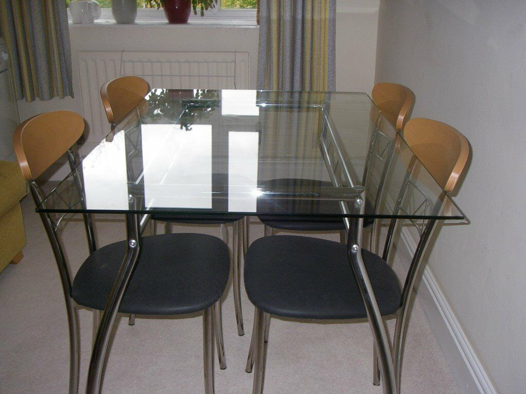 Glass top Table and 4 matching chrome and wood chairs.