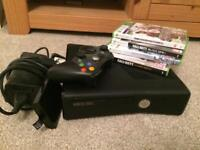 Xbox 360 black edition with controller and 4 games