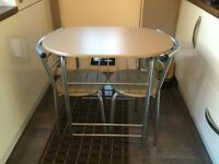 Space saving Table with 2 Chairs.