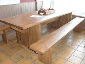 Large rustic dining table with matching bench stools