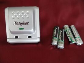 ENERGIZER PLUG-IN RECHARGEABLE BATTERY CHARGER. INCLUDES FOUR RECHARGEABLE BATTERIES