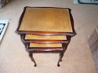 Nest of reproduction mahogany occasional tables