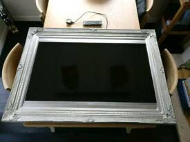 """Toshiba 40"""" TV in matching frame"""