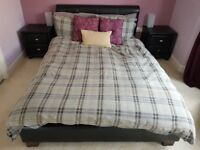 Double Bed frame, 2 x side cabinets and 6 drawer cabinet. Black faux leather.