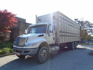 2014 International Dura Star Live stock box, or your choice of b