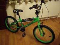 HALFORDS CONCEPT ZOMBIE BOYS BMX BIKE WOULD SUIT A 7 TO 10 YEAR OLD .