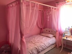 Beautiful four poster bed with curtains