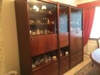 Dark solid wood sideboard with plenty of display cabinets, storage and bar