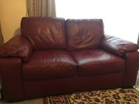 Two seater burgundy sofa