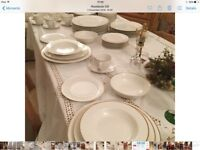 Fine porcelain 57 piece Dinner service in white with gold rim
