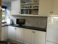 White kitchen units and stainless steel sink