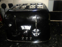 delongi toaster 4 slice in very good condition & working order