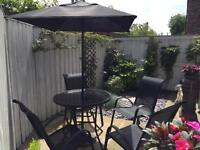 Garden table 4 chairs and parasol