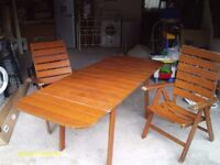 EXTENDABLE TEAK PATIO TABLE WITH PAIR OF SOLID ADJUSTABLE CHAIRS AND COVERS