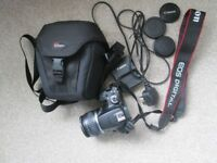 CANON E0S 1000D CAMERA, WITH LENS, CHARGER & BAG. USED 3 TIMES