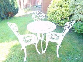 Ornate Metal Patio Table & Three Chairs