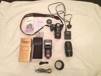 Canon 450d digital slr 12mp with 2 lenses 18-55 & 75-300, speedlite, and accessories