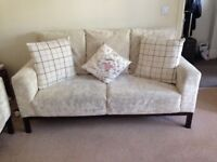 Two white sofas and footstool