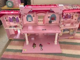 Girls plastic dolls house