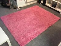 Giant pink shaggy rug