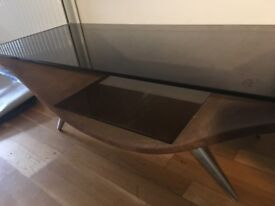COFFEE TABLE - Heavy glass top, Brown suede bottom.