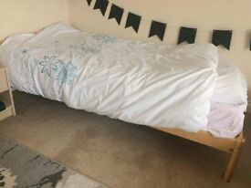 Single bed with matress.