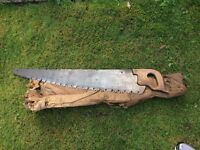 Vintage cross cut logging tree saw with vintage wood