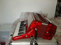 Rossini accordion hardly used. Dappled red . Carry case included Collection only Sold as seen £150