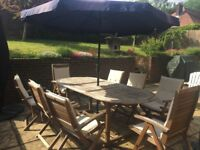 Wooden garden table and 8 chairs, cushions and umbrella