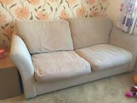 Beige 2 seater sofa bed