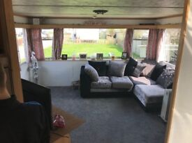 Beautiful Mobile Home- 2 bedrooms, garden, kitchen, dining area, lounge, unsuite, bathroom.